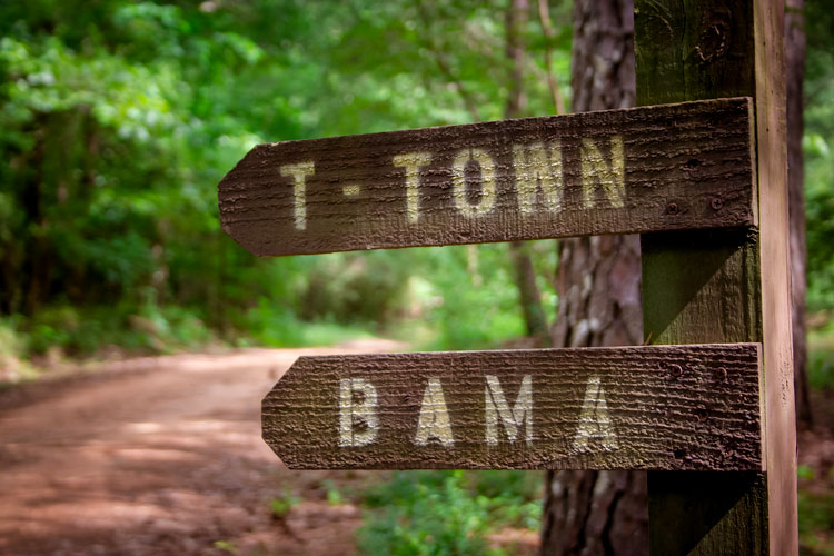 Sign pointing to T-Town and Bama